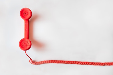 red-wired-telephone-white-background